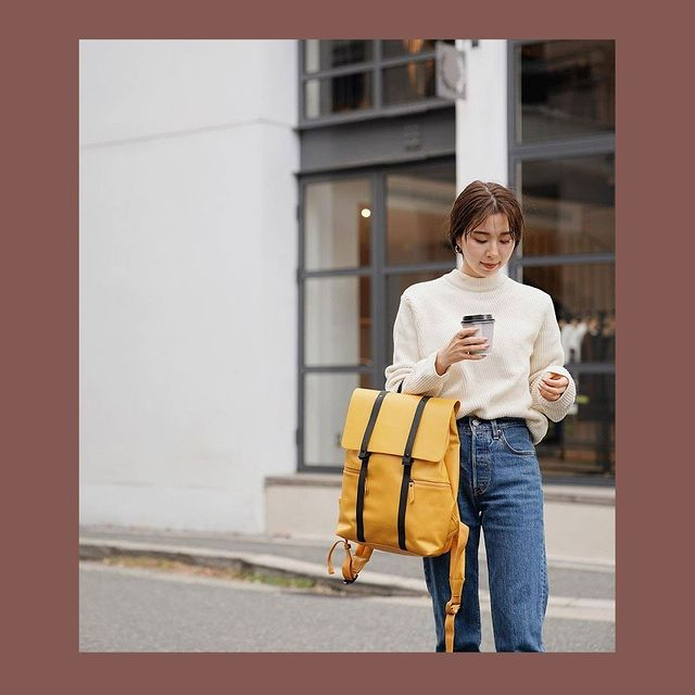 "Our Spläsh 13"" backpack in Mustard is perfect for adding a pop of colour to your outfit. ⭐⁠ ⁠ (Photo via @janis_global)⁠ #AnywhereWithGL #GastonLuga⁠"