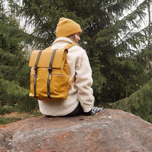 """Check out @momentsbybelle out on a journey with her Spläsh 13"""" backpack in Mustard!   #CarryYourLife #AnywhereWithGL  #GastonLuga"""