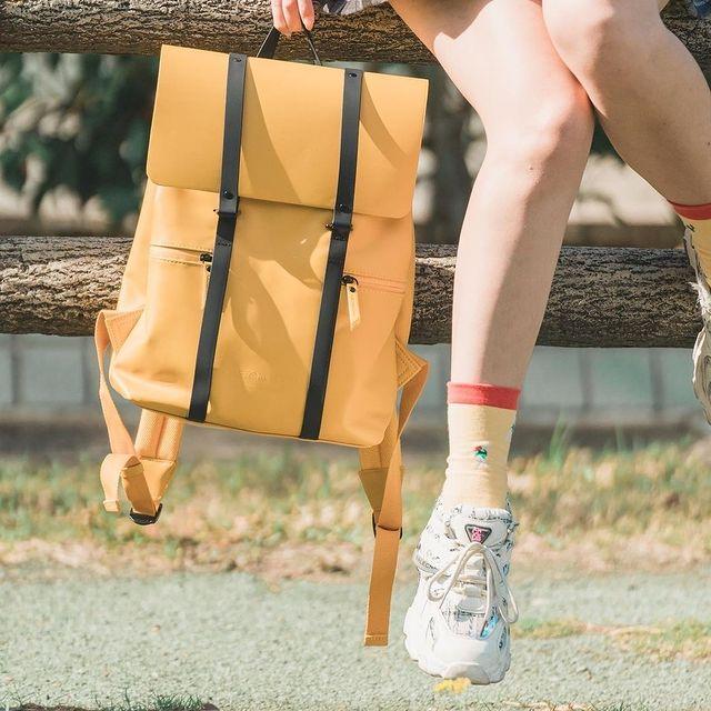 "Our Spläsh 13"" backpack in mustard yellow is definitely a crowd favourite ☀️   (Photo via @murmur_linn) #AnywhereWithGL #GastonLuga #spläshmustardblack"