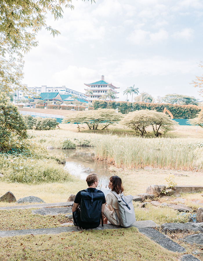 @alifeofattraction with taupe Rullen waterproof backpack journey at a lotus pond in Singapore