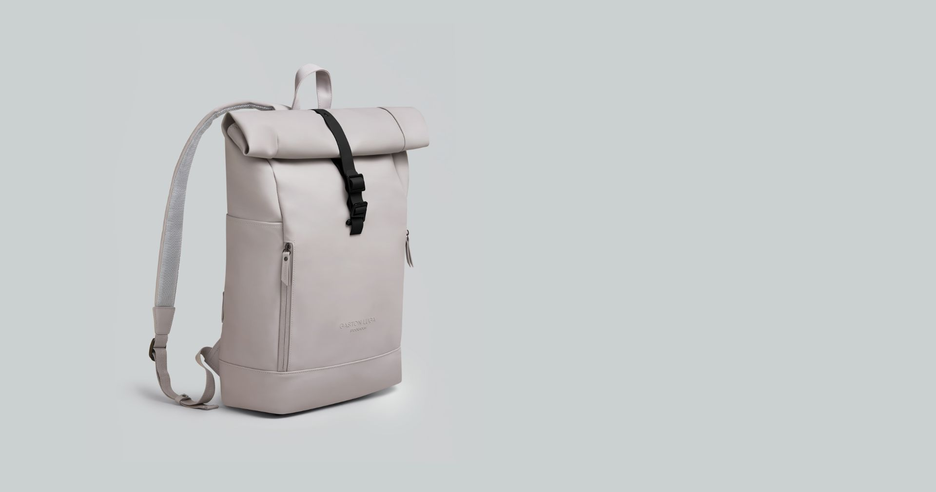 Taupe Rullen waterproof backpack on a podium in studio